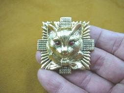 large cat head with bow ribbon on square starburst brass pi
