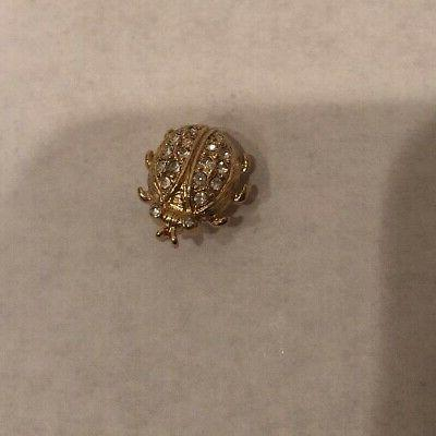 lady bug gold tone with clear stones
